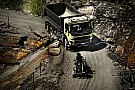 Hamster steers a 15-tonne Volvo FMX truck up a quarry [video]